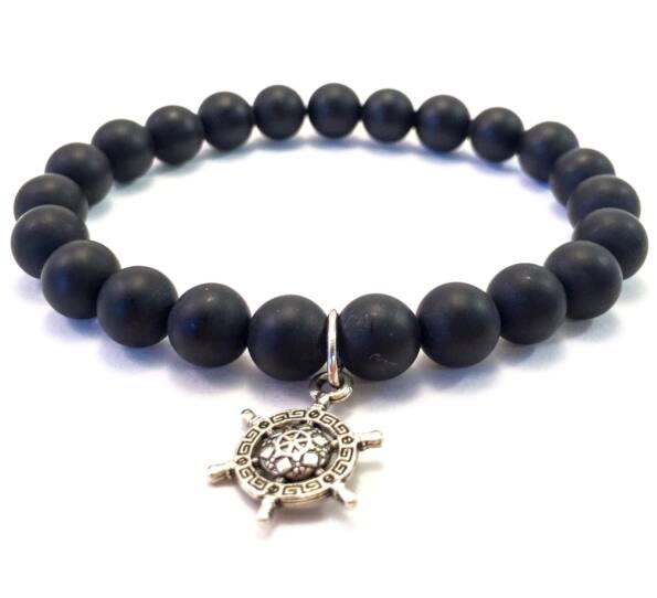 Matte onyx bracelet with ship rudder pendant