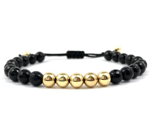 Faceted onyx and gold pearl cord bracelet