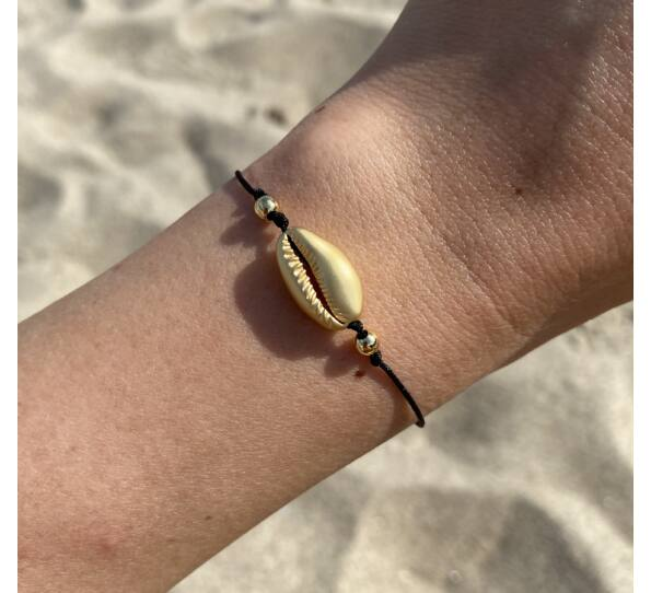 Matte gold shell string bracelet